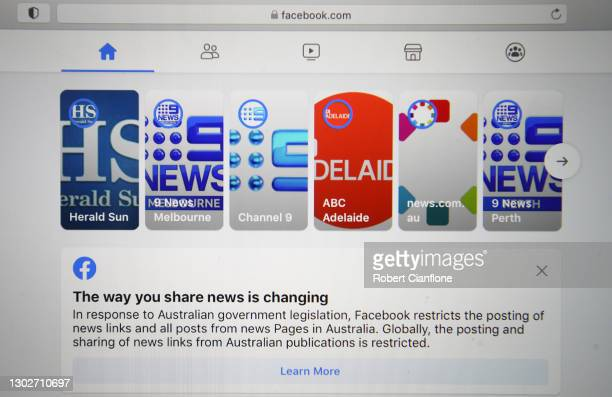 In this photo illustration various news sites are seen on Facebook on February 18, 2021 in Melbourne, Australia. Facebook has banned publishers and...