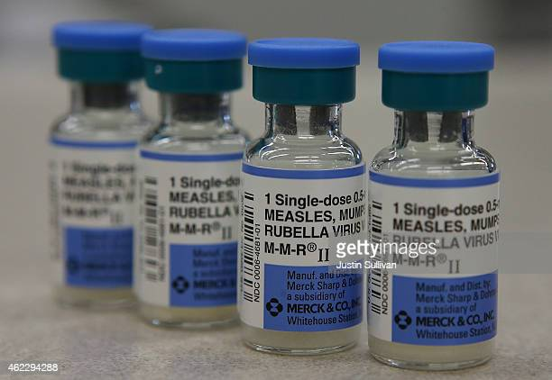 In this photo illustration vials of measles mumps and rubella vaccine are displayed on a counter at a Walgreens Pharmacy on January 26 2015 in Mill...