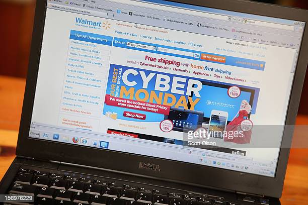 In this photo illustration, Walmart advertises Cyber Monday sales on the company's website on November 26, 2012 in Chicago, Illinois. Americans are...
