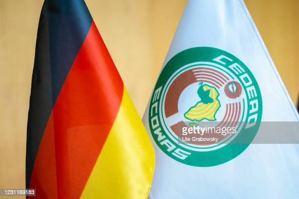 In this photo illustration you have a flag of Germany, CEDEAO, ECOWAS on February 08, 2021 in Bonn, Germany.