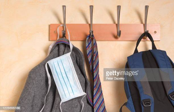 In this photo illustration,a School uniform hangs up with a face mask on May 18,2020 in London,England.