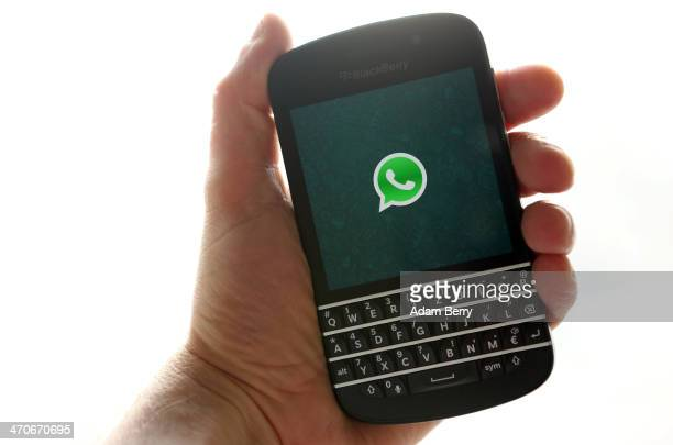 In this photo ilustration the WhatsApp startup screen is seen on a Blackberry Q10 mobile phone on February 20 2014 in Berlin Germany The social...