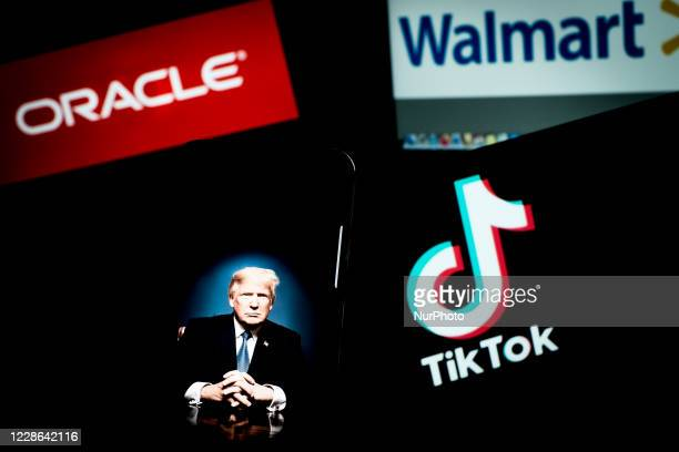 In this photo is seen the TikTok logo on a smartphone with Oracle and Walmart wallpaper with the president of the USA on September 20, 2020 in Rome,...
