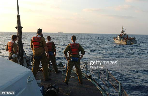In this photo made available by the IDF, Israeli sailors patrol with their Dabour missile boats off Israel's coast August 11, 2004 during an exercise...