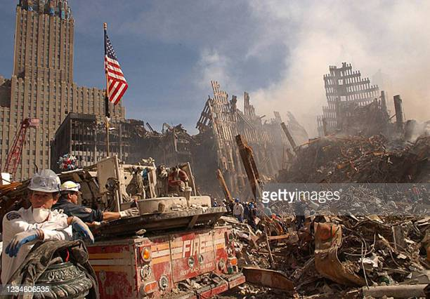 In this photo obtained 18 September 2001 from the Federal Emergency Management Agency , firefighters and Urban Search and Rescue workers battle...