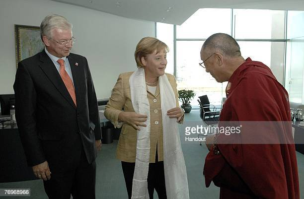 In this photo provided by Bundesregierung Hessen's State Premier Roland Koch and German Chancellor Angela Merkel meet with the Dalai Lama in the...