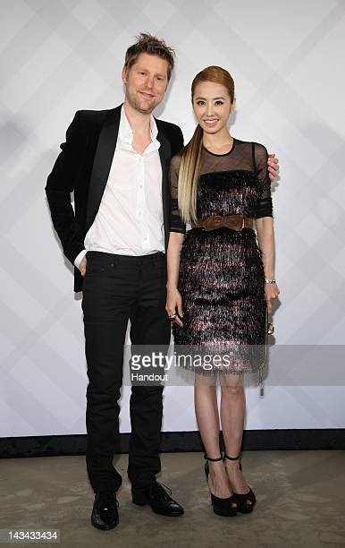 In this photo provided by Burberry Christopher Bailey and Jolin Tsai attend the opening of the Burberry 101 Flagship Store on April 26 2012 in Taipei...
