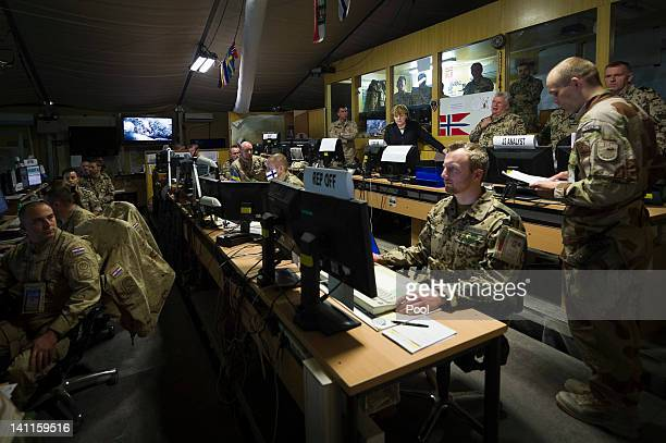 In this photo provided by German Government Press Office German Chancellor Angela Merkel visits the German Bundeswehr troops Command Joint Operation...
