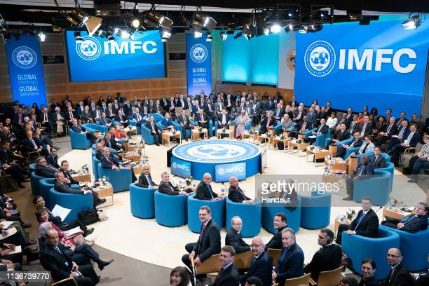 In this photo provided by IMF, 24 member International Monetary and Financial Committee including the International Monetary Fund Managing Director...