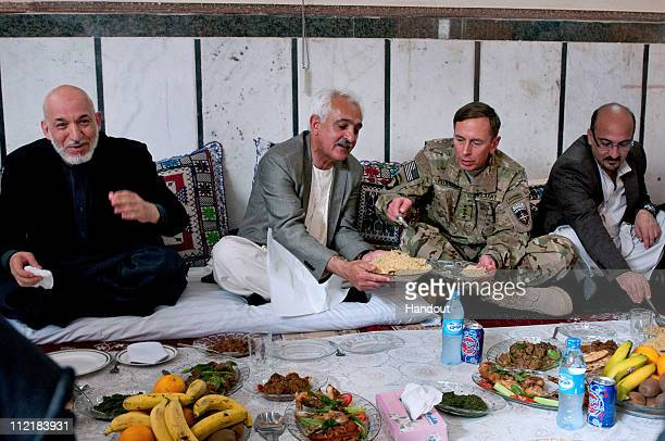 In this photo provided by ISAF Headquarters, U.S. Army Gen. David H. Petraeus , commander of NATO and International Security Assistance Force troops...