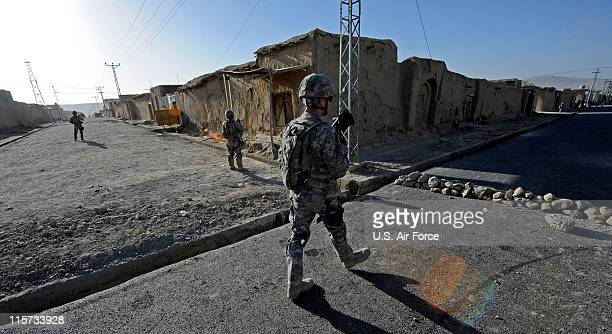 In this photo provided by ISAF Regional Command /US Air Force members of Provincial Reconstruction Team Zabul provide security while engineers...