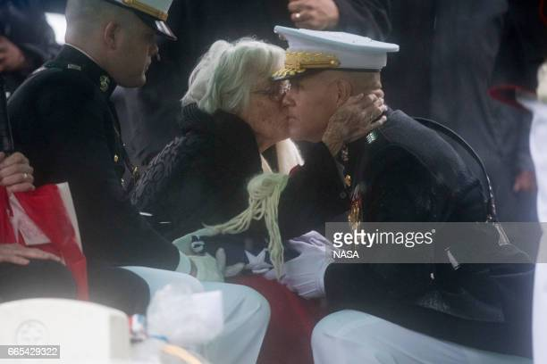 In this photo provided by NASA Annie Glenn wife of former astronaut and US Senator John Glenn gives the Commandant of the US Marine Corps General...