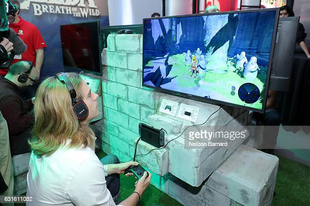 In this photo provided by Nintendo of America A guest enjoys playing The Legend of Zelda Breath of the Wild on the groundbreaking new Nintendo Switch...