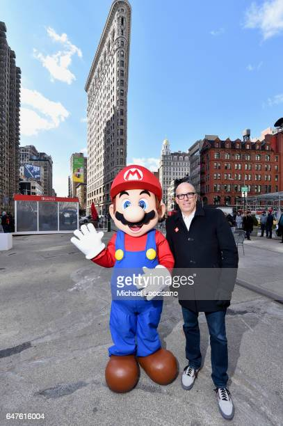 In this photo provided by Nintendo of America, Doug Bowser, Senior Vice President Sales and Marketing, poses with Mario at the Nintendo Switch in...
