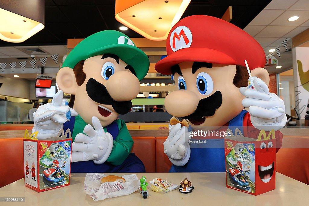 Mario and Luigi Celebrate the Release of Mario Kart 8 At McDonald's : News Photo
