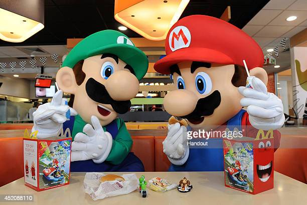 In this photo provided by Nintendo of America Mario and Luigi enjoy Happy Meals on July 12 2014 in Los Angeles California Nintendo is celebrating the...
