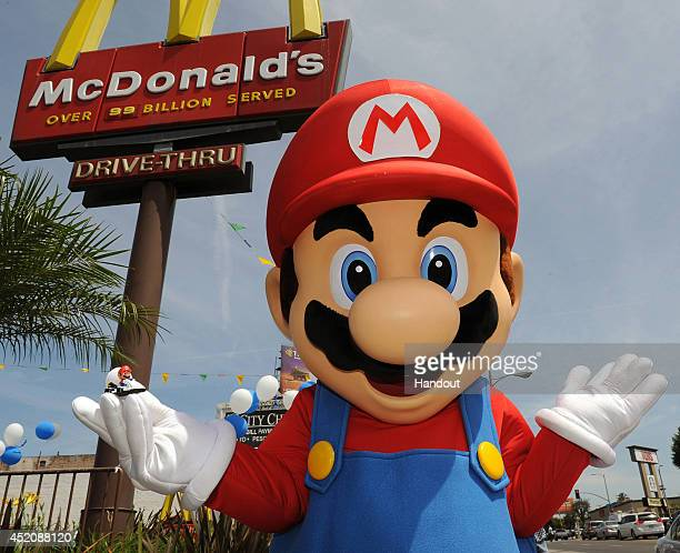 In this photo provided by Nintendo of America Mario shows off one of the Mario Kart 8 themed Happy Meal toys at a McDonald's restaurant on July 12...