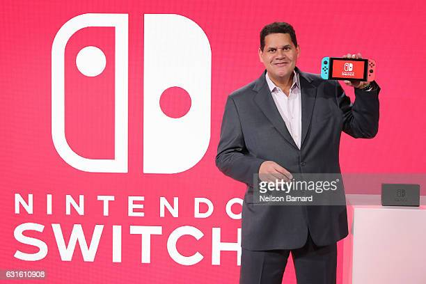 In this photo provided by Nintendo of America Nintendo of America President and COO Reggie FilsAime debuts the groundbreaking Nintendo Switch at a...