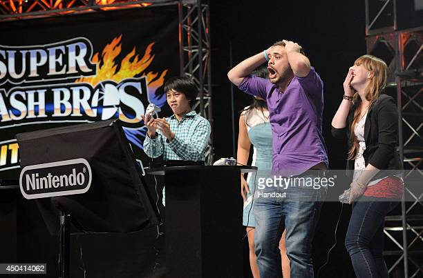 In this photo provided by Nintendo of America semifinalist Juan Hungrybox Debiedma of Orlando Florida reacts to a multiplayer battle during the Super...