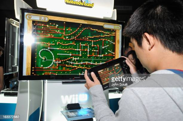 In this photo provided by Nintendo of America video game fans enjoy the latest Nintendo experiences at the SXSW Gaming Expo in Austin Texas sponsored...
