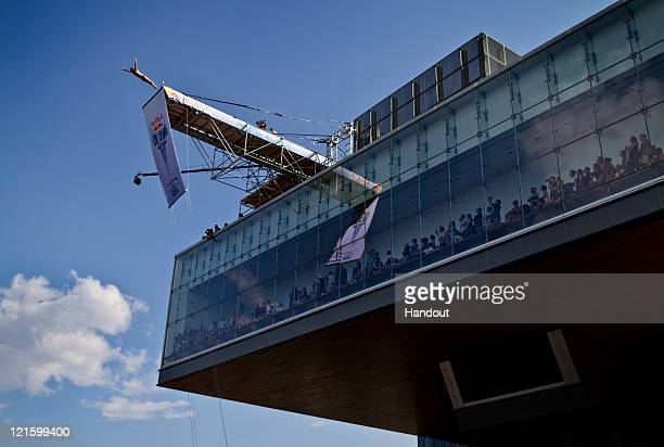 In this photo provided by Red Bull Kent De Mond of the USA dives from the 265 meter platform on the Institute of Contemporary Art building during the...