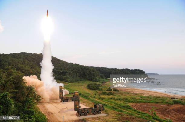 In this photo provided by South Korea Defense Ministry South Korea's Hyunmoo II ballistic missile is fired during an exercise at an undisclosed...