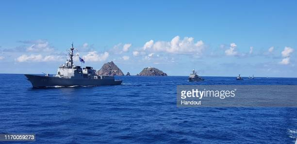 In this photo provided by South Korean Navy, South Korean Navy's Aegis destroyer, King Sejong the Great, sails during the drill on the islets called...