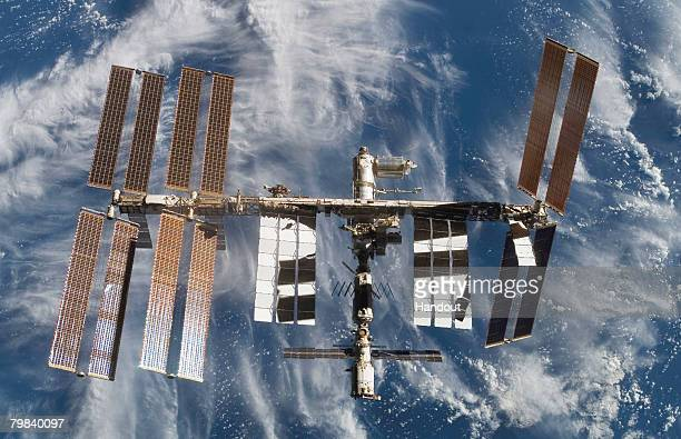 In this photo provided by the European Space Agency and NASA the International Space Station is seen from Atlantis as the orbiter undocks February 18...