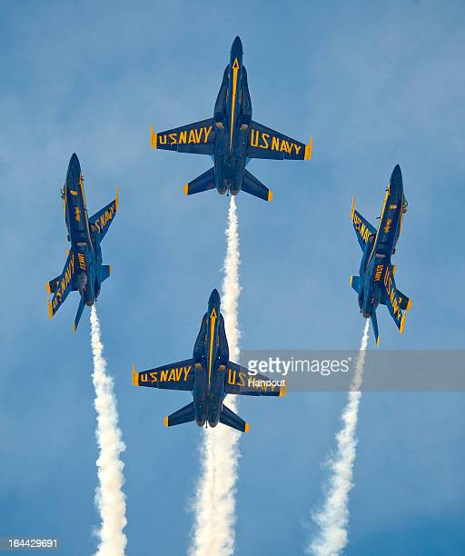 In this photo provided by the Florida Keys News Bureauthe US Navy's Blue Angels perform their precision aerobatics over the Florida Keys during the...