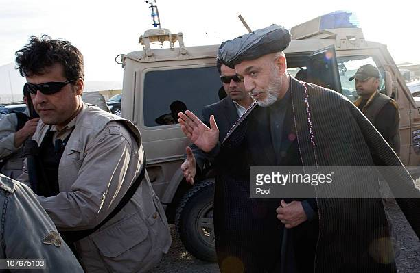 In this photo provided by the German Government Press Office Afghan President Hamid Karzai arrives to meet German Chancellor Angela Merkel for...