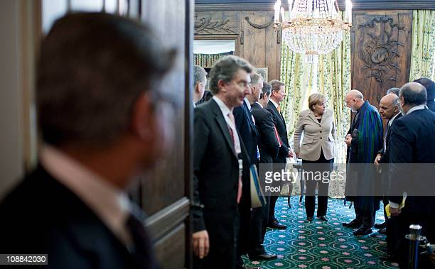 In this photo provided by the German Government Press Office Afghan President Hamid Karzai and German Chancellor Angela Merkel speak during the...