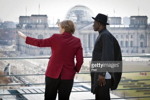 In this photo provided by the German Government Press Office Chancellor Angela Merkel of Germany talks with Nigerian president Goodluck Ebele...