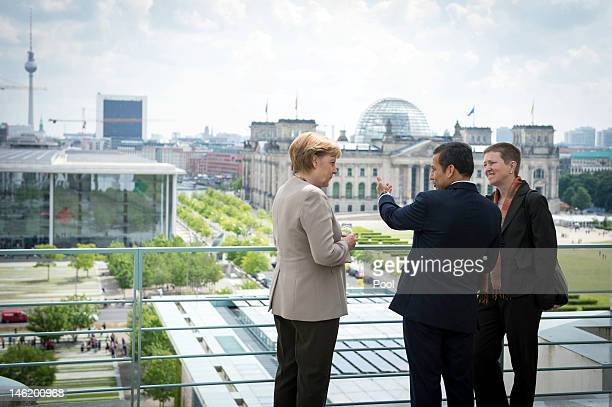 In this photo provided by the German Government Press Office Chancellor Angela Merkel talks talks with Peruvian President Ollanta Humala Tasso with...