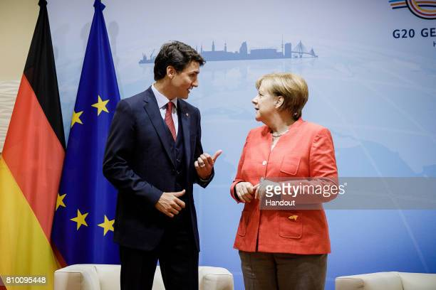 In this photo provided by the German Government Press Office Chancellor Angela Merkel welcomes Justin Trudeau Prime Minister of Canada to a bilateral...