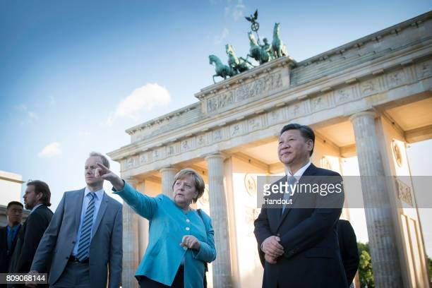 In this photo provided by the German Government Press Office At the beginning of her meeting with Chinese President Xi Jinping Chancellor Angela...