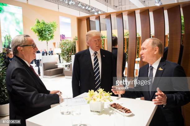 In this photo provided by the German Government Press Office Donald Trump President of the USA meets Vladimir Putin President of Russia and President...