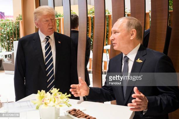 In this photo provided by the German Government Press Office , Donald Trump, President of the USA meets Vladimir Putin, President of Russia during...