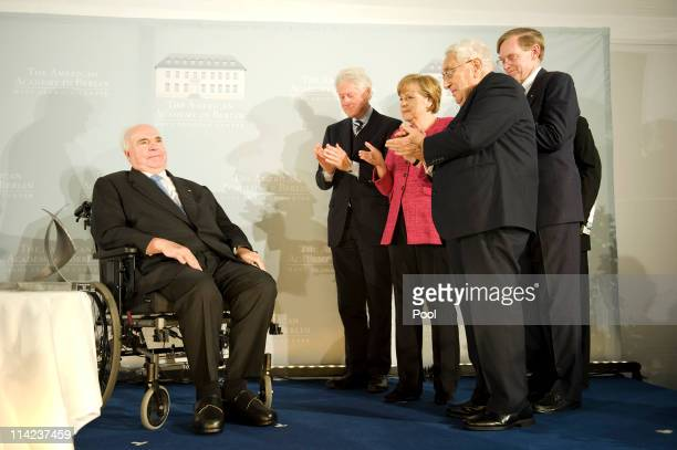 In this photo provided by the German Government Press Office Former German Chancellor Helmut Kohl gets applause by former US President Bill Clinton...