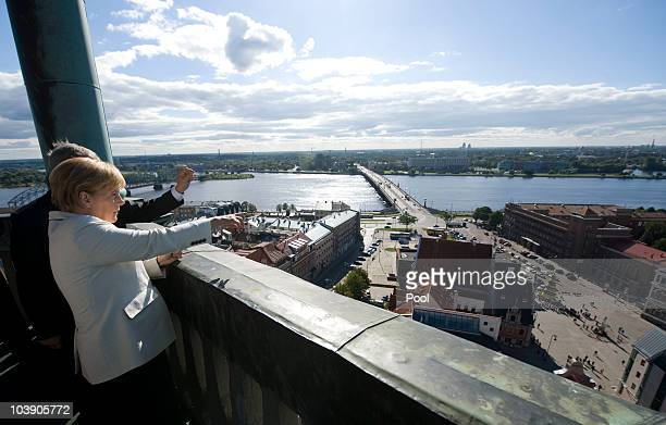 In this photo provided by the German Government Press Office German Chancellor Angela Merkel enjoys the view from the tower of the St Petri Church to...
