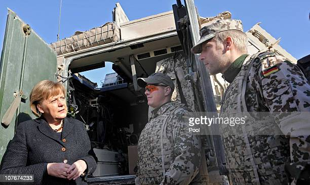 In this photo provided by the German Government Press Office German Chancellor Angela Merkel talks to soldiers during her visit at ISAF soldier camp...