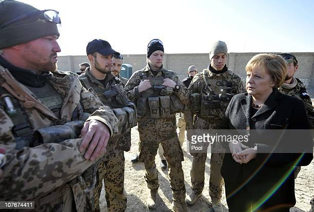 In this photo provided by the German Government Press Office German Chancellor Angela Merkel visits an ISAF soldier camp on December 18 2010 in...