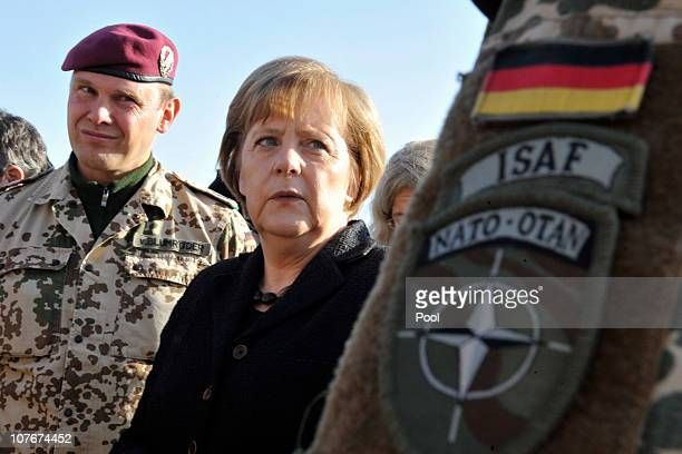 In this photo provided by the German Government Press Office, German Chancellor Angela Merkel visits an ISAF soldier camp on December 18, 2010 in...