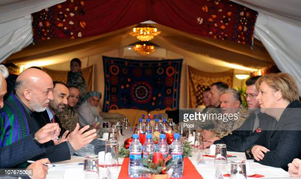 In this photo provided by the German Government Press Office German Chancellor Angela Merkel and Afghan President Hamid Karzai meet for political...