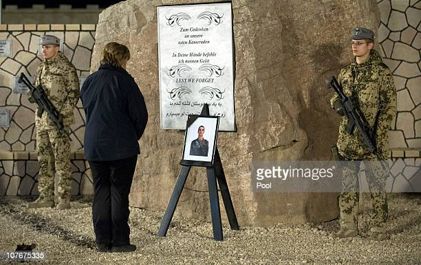 In this photo provided by the German Government Press Office German Chancellor Angela Merkel attends a commemorative ceremony for the soldier who...