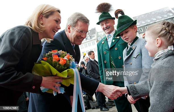 In this photo provided by the German Government Press Office German President Christian Wulff and his wife First Lady Bettina Wulff are welcomed by a...