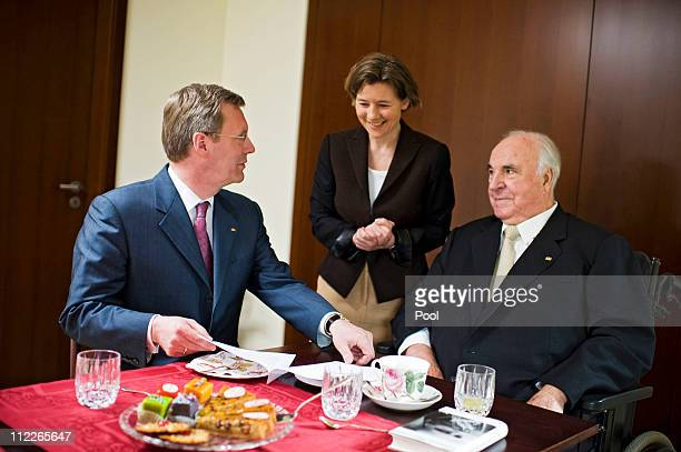 In this photo provided by the German Government Press Office German President Christian Wulff visits former German Chancellor Helmut Kohl and his...