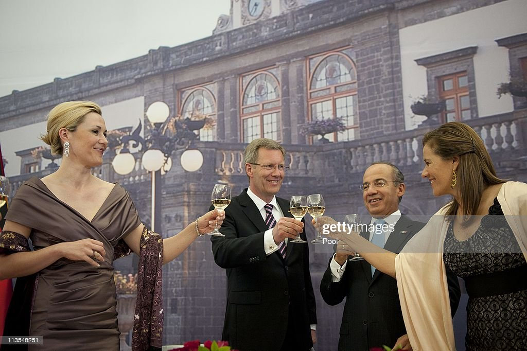 In this photo provided by the German Government Press Office, German President Christian Wulff (2ndL) and his wife First Lady Bettina (L) get together with Mexican President Felipe Calderon (2ndR) and his wife Margarita Zavala (R) during a state banquet at Castillo de Chapultepec on May 02, 2011 in Mexico City, Mexico. Wulff and his wife are on a two visit to Mexico.