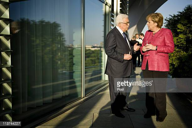 In this photo provided by the German Government Press Office German Chancellor Angela Merkel and Palestinian Authority President Mahmoud Abbas talk...
