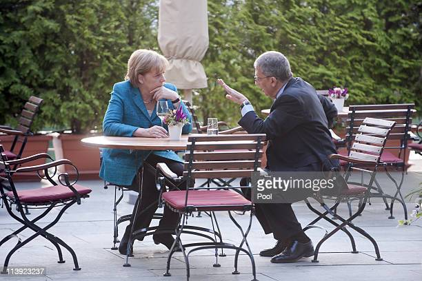 In this photo provided by the German Government Press Office German Chancellor Angela Merkel talks to Amre Moussa, Secretary General of the League of...