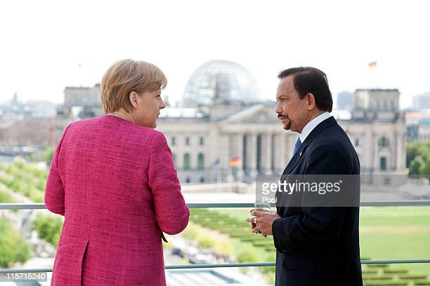 In this photo provided by the German Government Press Office German Chancellor Angela Merkel talks to Brunei's Sultan Haji Hassanal Bolkiah at the...
